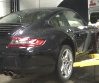 Porsche Carrera 4S being serviced