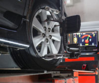 car on a stand for a wheel alignment